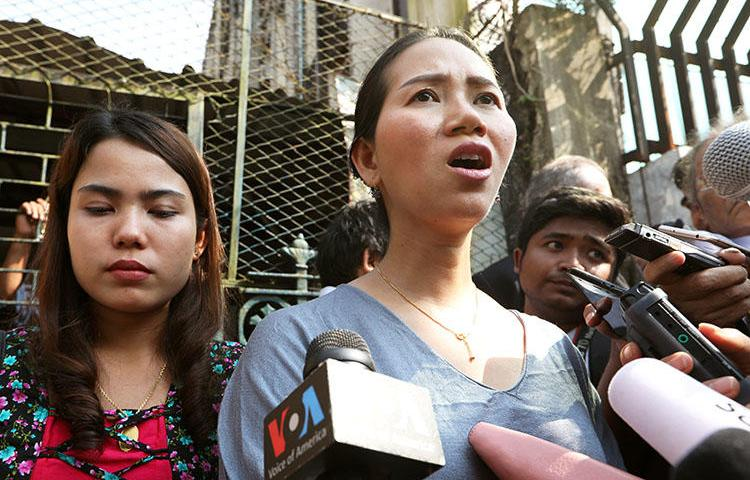 Pan Ei Mon, left, and Chit Su Win, wives of jailed Reuters reporters Wa Lone and Kyaw Soe Oo, talk to media after their appeal was rejected by a court in Yangon, Myanmar, on January 11, 2019. (Reuters/Ann Wang)