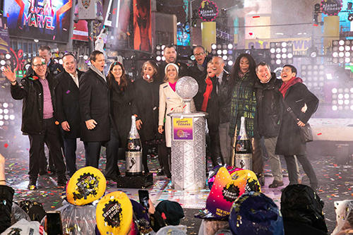 CPJ Executive Director Joel Simon, left, onstage with journalists in Times Square on New Year's Eve. (Times Square Alliance/Amy Hart)