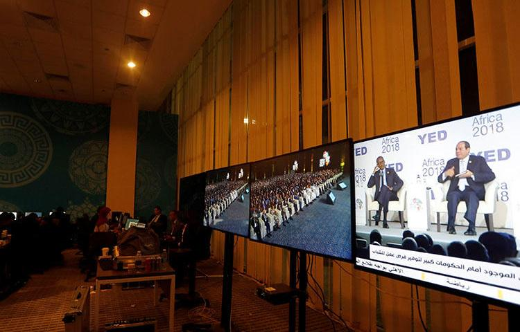 Egyptian President Abdel Fattah al-Sisi is seen on a television screen at the press center during the Africa 2018 Forum in Sharm el-Sheikh, Egypt, on December 8, 2018. An Egyptian TV presenter was sentenced to prison for an interview with a gay man on January 20, 2019. (Reuters/Amr Abdallah Dalsh)