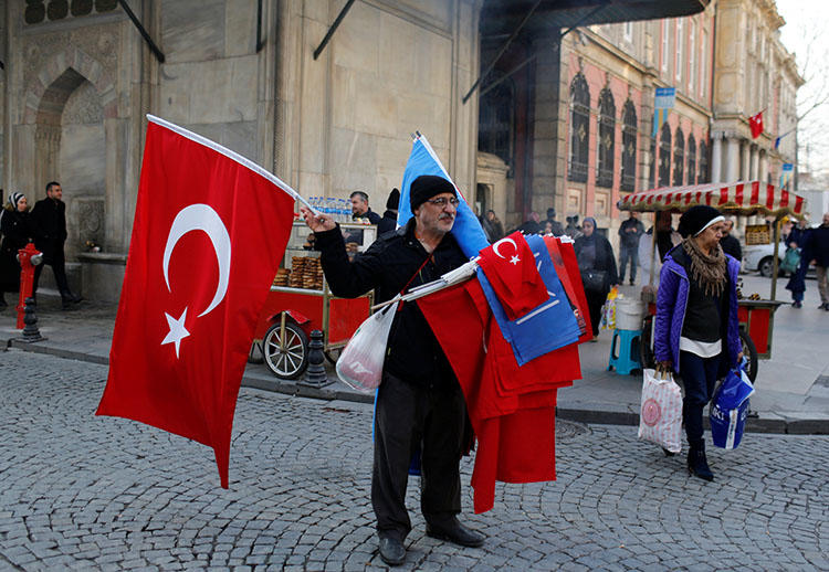 A street vendor in Istanbul sells Turkish flags on December 31. Turkey's media regulator has fined two news broadcasters over their critical commentary. (Reuters/Murad Sezer)