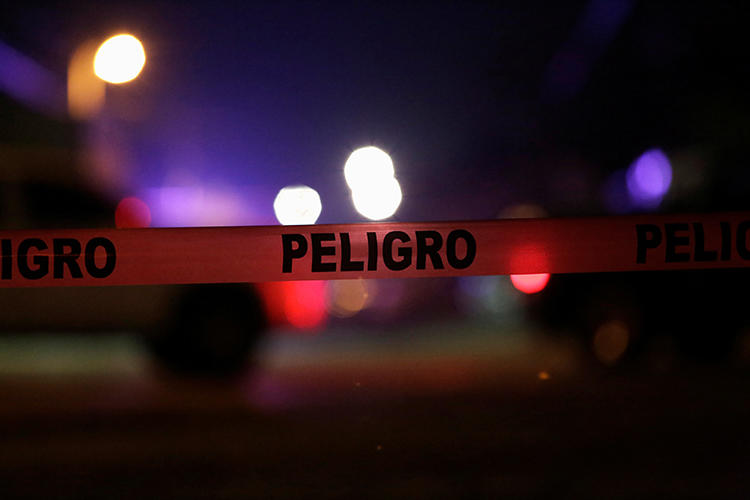 "A Mexican police cordon reading ""Danger"" is pictured at a crime scene on January 4, 2018. Community radio station director Rafael Murúa Manríquez was recently killed in northern Mexico. (Jose Luis Gonzalez/Reuters)"