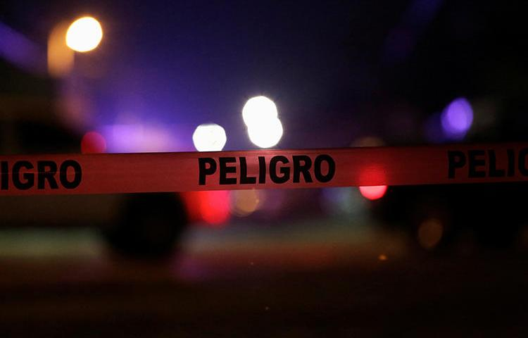 """A Mexican police cordon reading """"Danger"""" is pictured at a crime scene on January 4, 2018. Community radio station director Rafael Murúa Manríquez was recently killed in northern Mexico. (Jose Luis Gonzalez/Reuters)"""