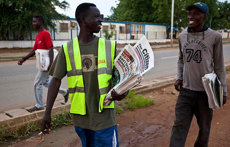 Newspaper vendors chat on their way to sell newspapers in Juba, South Sudan. Recently, the South Sudanese government has attempted to restrict local newspapers' ability to cover the ongoing political crisis in neighboring Sudan. (Adriane Ohanesian/Reuters)