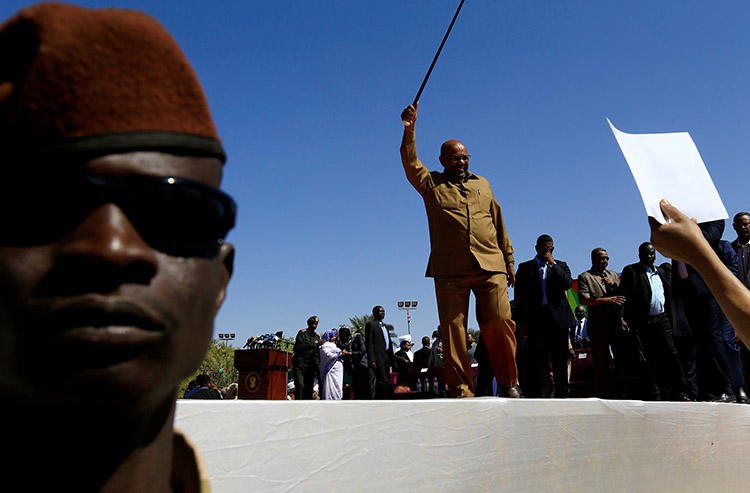 President Omar al-Bashir waves to supporters during a rally in Khartoum on January 9. Sudanese authorities have revoked the credentials of at least six journalists working for international outlets. (Reuters/Mohamed Nureldin Abdallah)