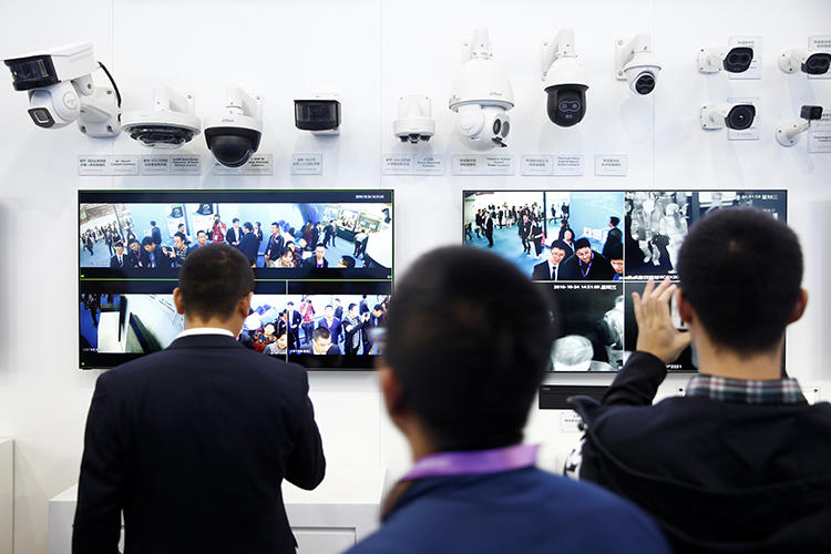 Visitors look at CCTV cameras at the Security China 2018 exhibition on public safety and security in Beijing on October 24, 2018. In a 2018 survey, foreign correspondents in China listed surveillance as their top concern. (Thomas Peter/Reuters)
