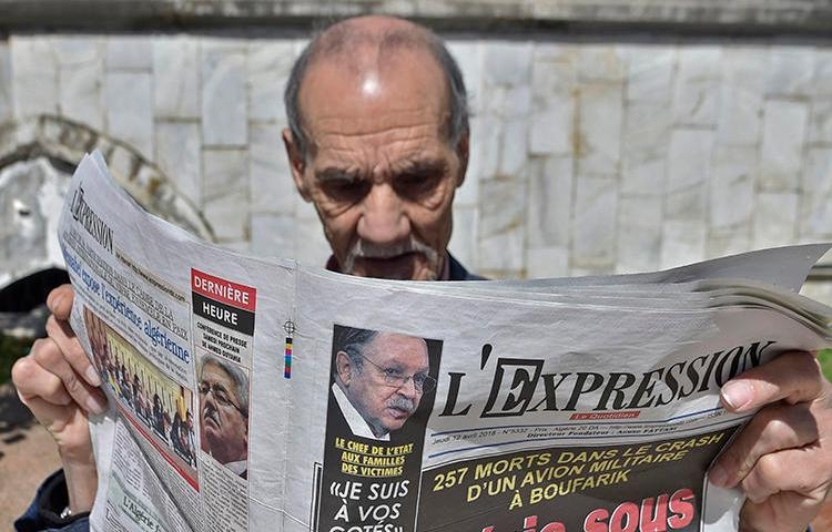 An Algerian man reads a newspaper in the capital, Algiers, on April 12, 2018. Adlène Mellah, founder of online news outlets Dzair Presse and Algerie-Direct, was recently handed a six-month suspended prison sentence in Algiers (Ryad Kramdi/AFP)