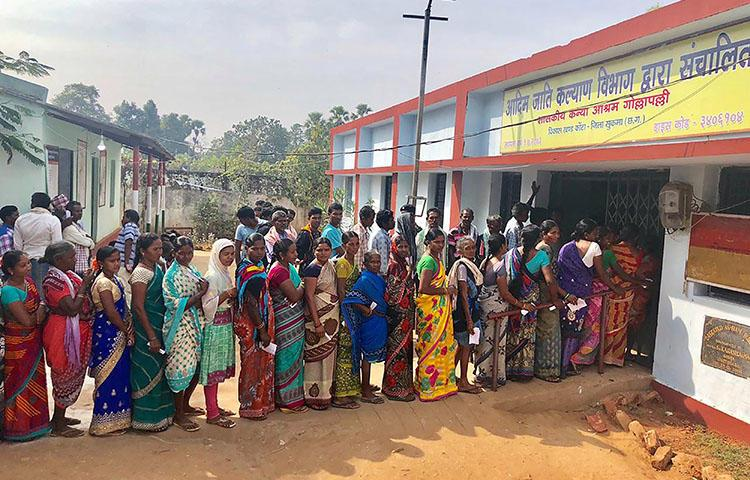 Voters line up at a polling station in Sukma in Chhattisgarh state on November 12, 2018. The state's newly elected state minister is setting up a committee to draft a journalist safety law. (AFP)