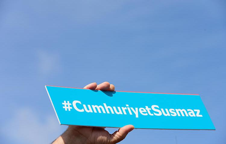 A sign reading 'Cumhuriyet will not be silent' is held during a protest outside Istanbul's court house in September 2017. An appeals court in February upheld the convictions of six staff at the paper. (AFP/Yasin Akgul)