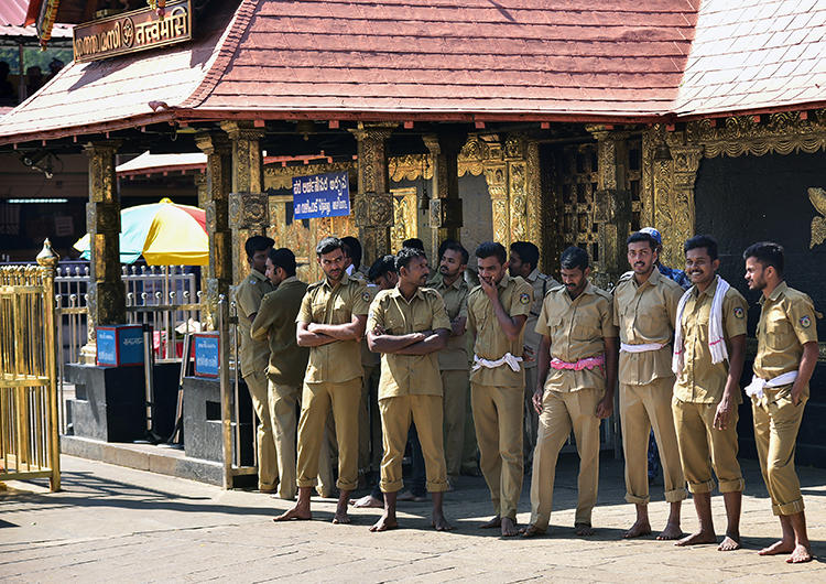 Indian police stand guard at the Ayyappa shrine at the Sabarimala temple in Kerala state on January 2, 2019. On January 23, two reporters were attacked while covering the shrine. (Image via AFP)