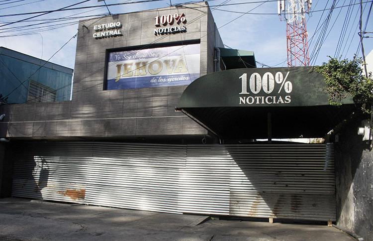 The 100% Noticias building is seen in Managua on December 22, 2018, one day after it was raided and closed by the Nicaraguan police. Two journalists from the broadcaster remain in detention. (Maynor Valenzuela/AFP)