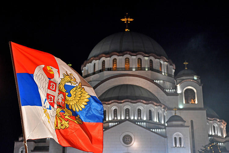 A Serbian flag in front of Saint Sava Church in Belgrade. Police are investigating after a threatening letter was sent to a Serbian TV station. (AFP/Andrej Isakovic)