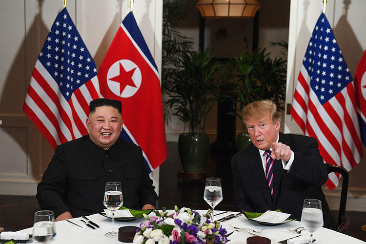 North Korean leader Kim Jong Un and US President Donald Trump at dinner in Hanoi on February 27. The White House blocked four journalists from covering the event. (AFP/Saul Loeb)