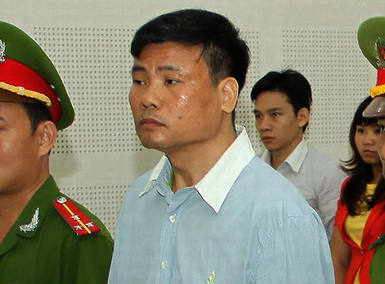 Blogger Truong Duy Nhat stands trial in Vietnam on March 4, 2014. He recently disappeared from Thailand and has resurfaced in a Vietnamese prison. (Vietnam News Agency via AFP)