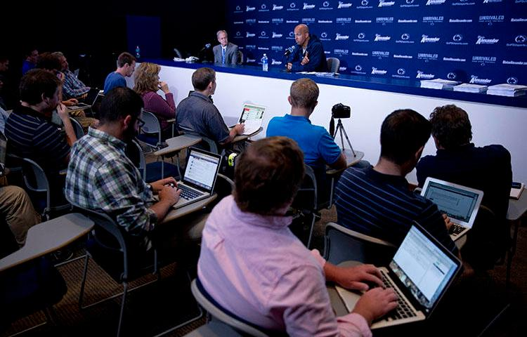 A Penn State news conference in 2014. A sports journalist who helped break the story about convicted Penn State coach Jerry Sandusky says she abandoned Twitter because of threatening messages. (AP/Matt Rourke)