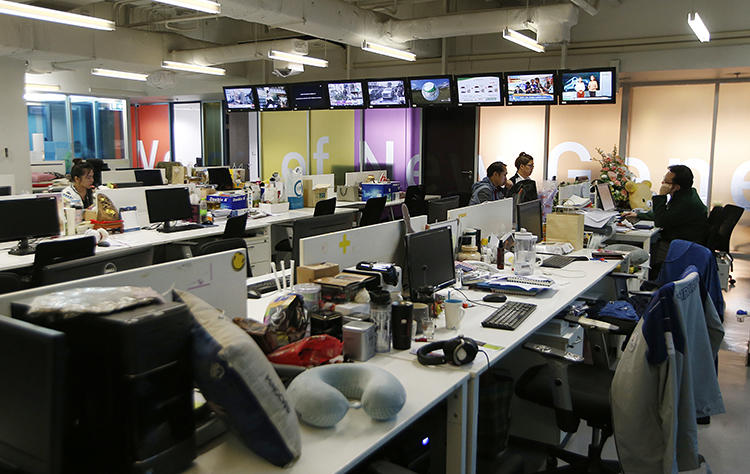 Voice TV station staff work in the newsroom in Bangkok, Thailand, on February 13, 2019. The TV station saw its broadcast license suspended by regulators in the run-up to the country's elections in March. (Sakchai Lalit/AP)