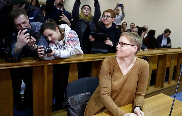 Marina Zolatava, editor-in-chief of the Belarusian independent news site Tut.by, sits in a Minsk court room prior to her preliminary hearing on two charges on February 12. (AP/Sergei Grits)