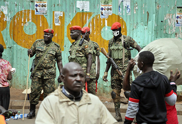 Ugandan military police are seen in Kampala on August 23, 2018. A BBC team was recently arrested while investigating corruption in the country. (Ronald Kabuubi/AP)