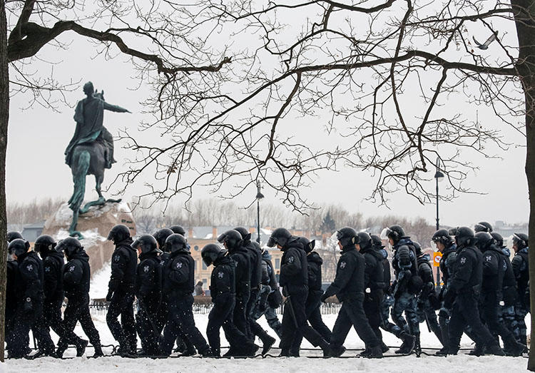 Police walk past a monument to Peter the Great during a rally of opposition supporters in Saint Petersburg on February 10. Jailed Russian journalist Igor Rudnikov is due in court in the city on February 14. (Reuters/Anton Vaganov)