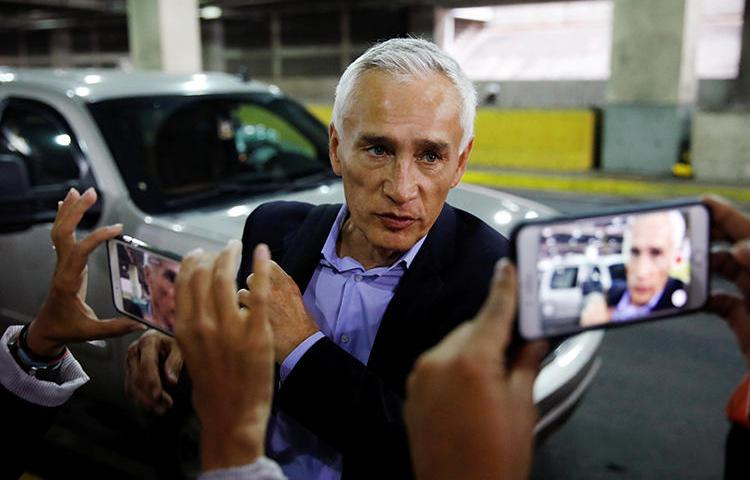 Jorge Ramos, anchor of Spanish-language U.S. television network Univision, talks to the media as he prepares to leave the country at the Simon Bolivar international airport in Caracas, Venezuela, on February 26, 2019. (Carlos Garcia Rawlins/Reuters)