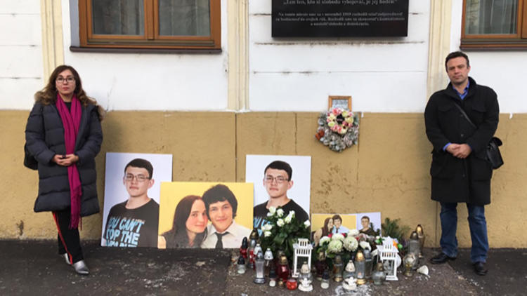 CPJ's Europe and Central Asia program coordinator Gulnoza Said, and EU representative Tom Gibson, pictured at a memorial for Slovak journalist Ján Kuciak and his fiancée Martina Kušnírová. (CPJ)