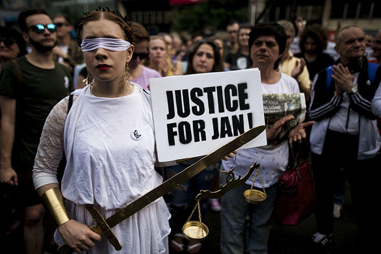 Demonstrators attend a protest in Bratislava, Slovakia, on May 4, 2018. Authorities have not identified the mastermind of the murders of journalist Jan Kuciak and his fiancee. (Vladimir Simicek/AFP)