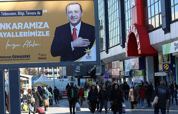 A campaign billboard for the ruling Justice and Development Party (AKP), pictured in Ankara on March 8. Police on March 19 detained a reporter and questioned her about her work in the capital. (AFP/Adem Altan)