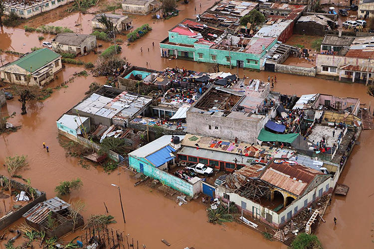 Residents stand on rooftops in a flooded area of Buzi, central Mozambique, on March 20, 2019, after the passage of cyclone Idai. (AFP/Adrien Barbier)
