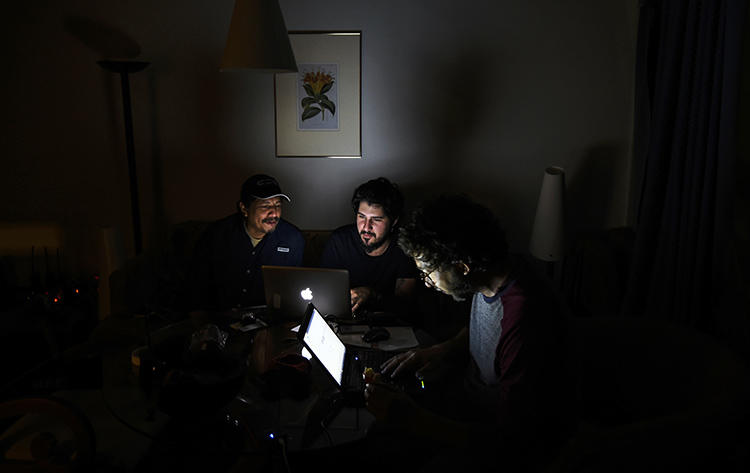 A photojournalist works in a Caracas hotel room during the third day of a massive power outage. Alongside power cuts, journalists must navigate internet blackouts imposed as Nicolás Maduro's government attempts to silence news of the opposition. (AFP/Juan Barreto)