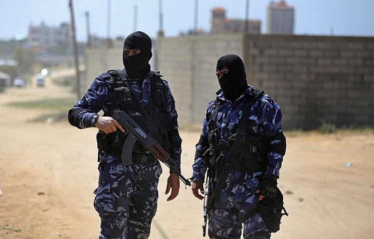 Palestinian members of the Hamas security forces patrol in the town of Nuseirat, central Gaza Strip, on March 22, 2018. Hamas detained at least 3 Palestinian journalists after Gaza cost-of-living protests in mid-March 2019. (AP Photo/Khalil Hamra)