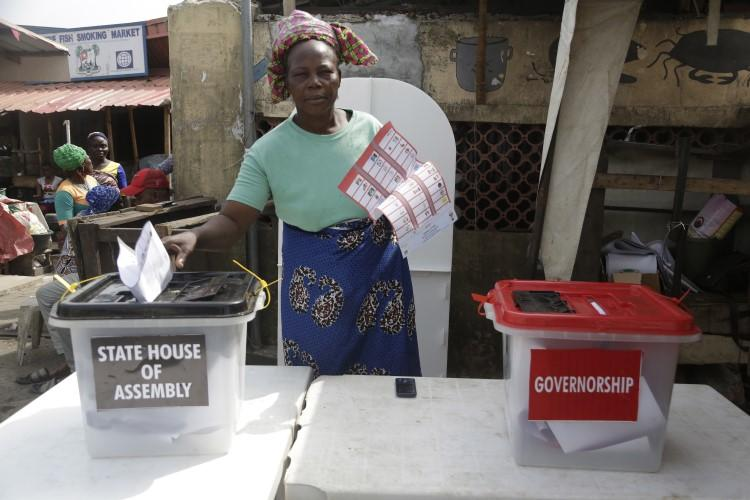 A woman casts her votes during the gubernatorial and state house assembly elections at a polling center in Lagos, Nigeria, on March 9, 2019. (Sunday Alamba/AP)