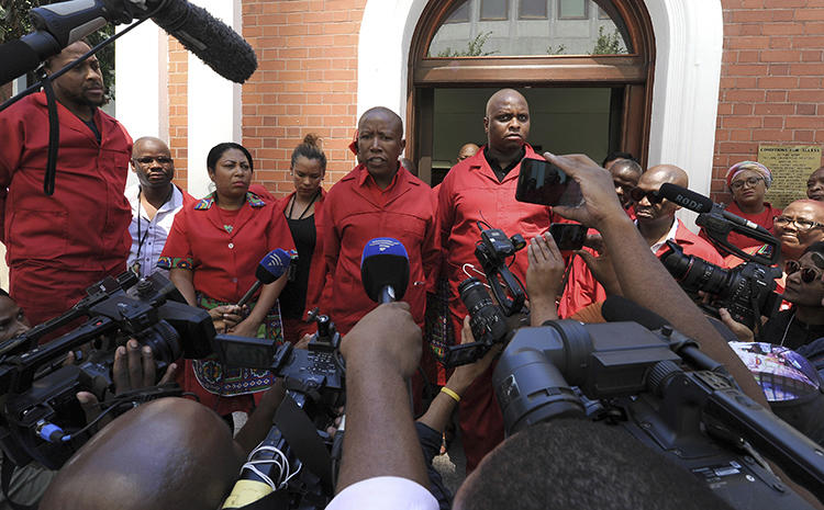 Members of the Economic Freedom Fighters (EFF) speak to the press in Cape Town, South Africa, on February 15, 2018. EFF leader Julius Malema doxxed prominent South African journalist Karima Brown on March 5, 2019, and she was later threatened, allegedly by party supporters. (AP Photo/Nasief Manie)