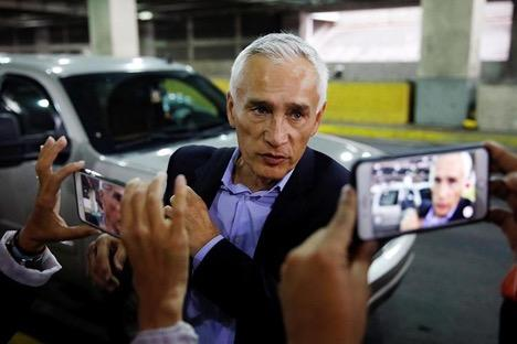 Jorge Ramos, anchor at Spanish-language U.S. television network Univision, talks to the media as he prepares to leave Venezuela at the Simon Bolivar international airport on February 26, 2019. (Carlos Garcia Rawlins/Reuters)