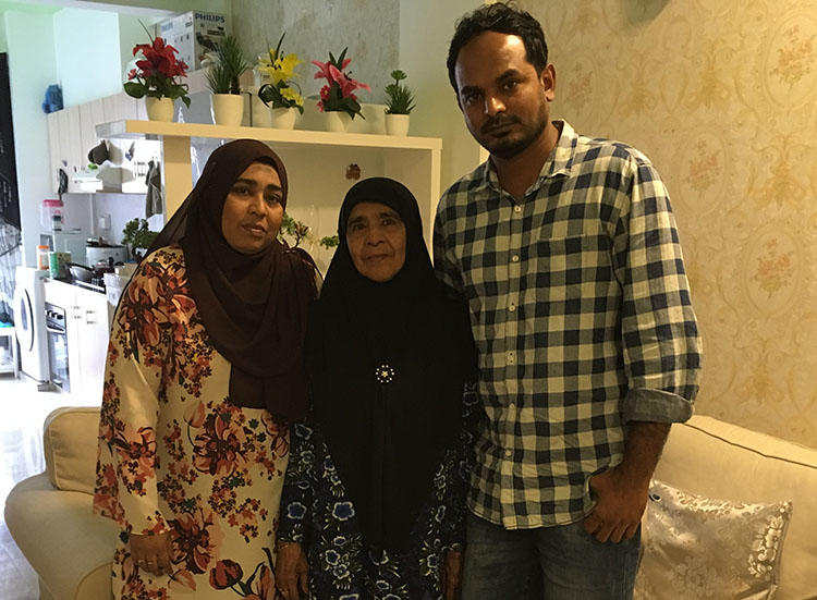 Ahmed Rilwan's mother, Aminath Easa, pictured center in her Malé home, with daughter Fathimath Shehenah and son Moosa. The family want answers to what happened five years ago. (CPJ)