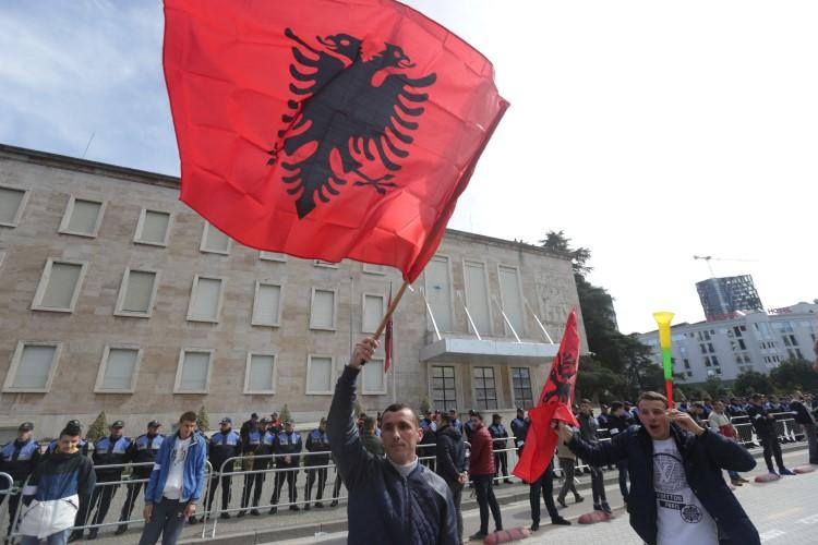 Protesters wave Albanian flags in Tirana, Albania, on March 16, 2019. A British journalist living in Albania has recently been attacked in a smear campaign after she gave comments on the RT network. (Florion Goga/Reuters)