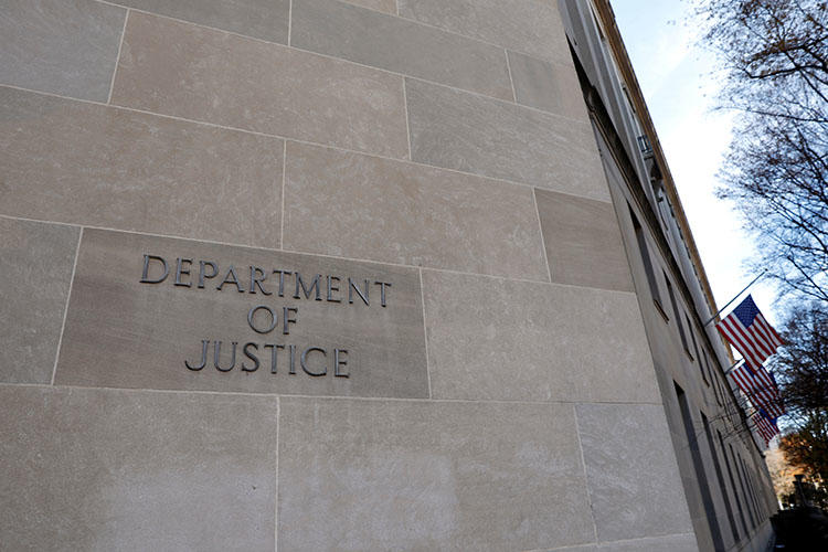 The Department of Justice building in Washington, D.C. The aggressive pursuit of people suspected of leaking information to the press is having an impact on reporting, national security journalists say. (Reuters/Yuri Gripas)