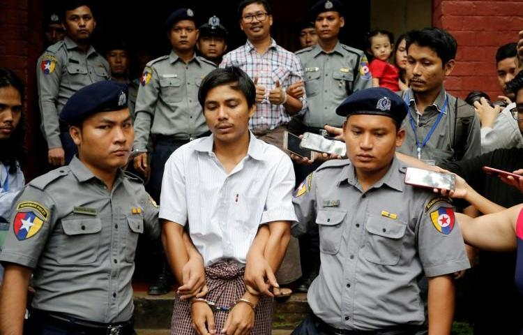 Detained Reuters journalists Kyaw Soe Oo and Wa Lone are escorted by police as they leave after a court hearing in Yangon, Myanmar, on August 20, 2018. The journalists will have their appeal heard at the Myanmar Supreme Court on March 26. (Ann Wang/Reuters)
