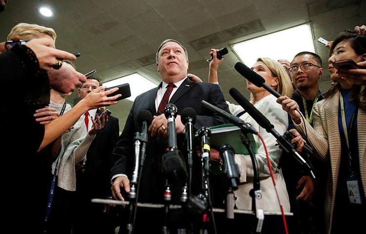 U.S. Secretary of State Mike Pompeo speaks to the media after a closed briefing for senators in November 2018, on developments related to the death of Saudi journalist Jamal Khashoggi. A joint letter calls for congressional action in the pursuit of justice. (Reuters/Joshua Roberts)