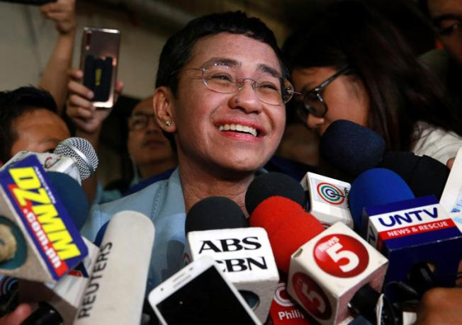 Maria Ressa, executive editor of news website Rappler, speaks to the media after posting bail in a cyber-libel case at a court in Manila City, Philippines, on February 14, 2019. Philippine authorities issued arrest warrants for Ressa and several other Rappler executives on March 28 in a separate case. (Reuters/Eloisa Lopez)