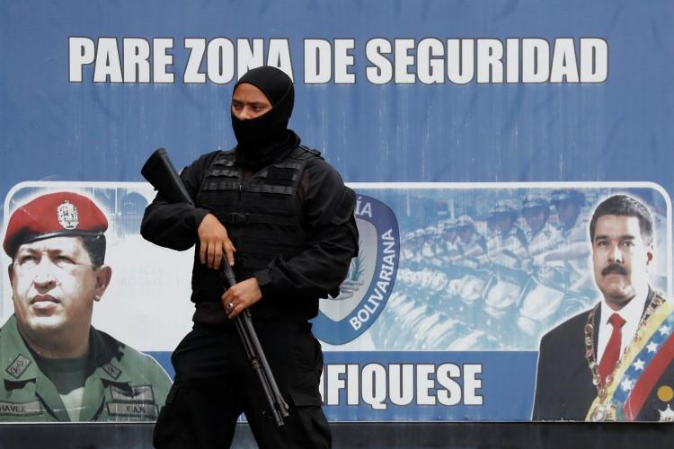 A member of the Bolivarian National Intelligence Service stands guard in Caracas, Venezuela, on May 16, 2018. Journalist Luis Carlos Díaz was recently detained by intelligence agents in Caracas. (Carlos Garcia Rawlins/Reuters)