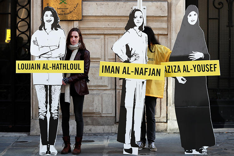 Demonstrators urge Saudi authorities to release jailed women's rights blogger Eman Al Nafjan and activists Loujain al-Hathloul and Aziza al-Yousef outside the Saudi Arabian embassy in Paris on March 8, 2019. Today, Al Nafjan and two activists were released from prison. (Benoit Tessier/Reuters)