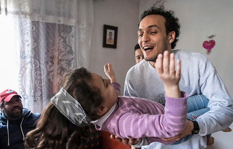 Egyptian photojournalist Shawkan plays with his niece at his home in Cairo after being freed from prison on March 4. As a condition of his release , Shawkan must return to custody every day at 6 p.m. (AFP/Khaled Desouk)