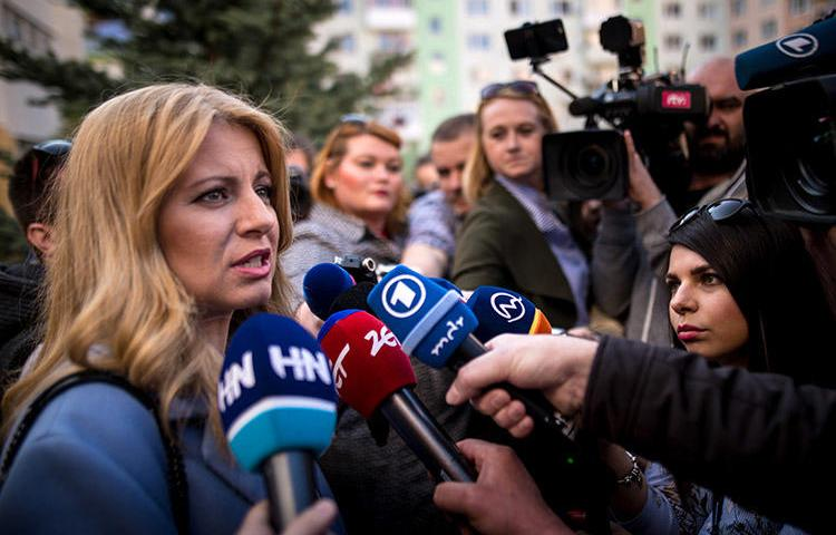 Slovakia's president-elect Zuzana Čaputová, pictured talking to the press outside a polling station in Pezinok on March 30. CPJ and other rights organizations are calling on the newly elected leader to ensure the safety of journalists. (AFP/Vladimir Simicek)