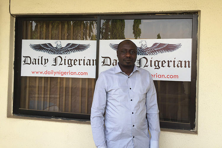 Jaafar Jaafar, of the Daily Nigerian, pictured outside the office of his newspaper in Abuja. (CPJ/Jonathan Rozen)
