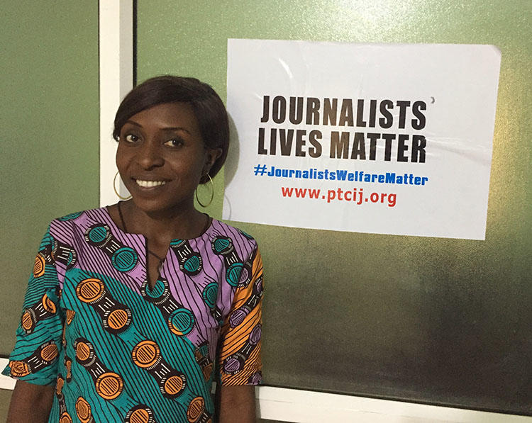 Evelyn Okakwu, a reporter for Premium Times, pictured at the Center for Investigative Journalism in Abuja. (CPJ/Jonathan Rozen)