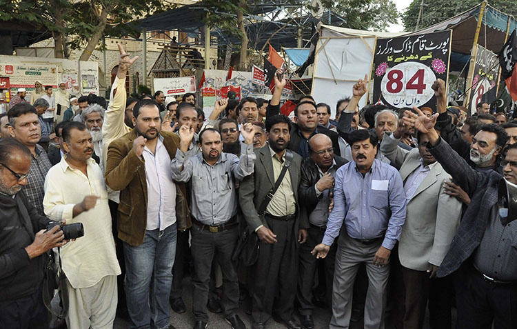 Pakistani journalists protest layoffs outside a press club in Karachi on December 17, 2018. Pakistan's military and security agencies exert pressure on local media, while the government slashes its advertising budget, squeezing a key source of revenue for private newspapers and TV stations. (AP/Fareed Khan)