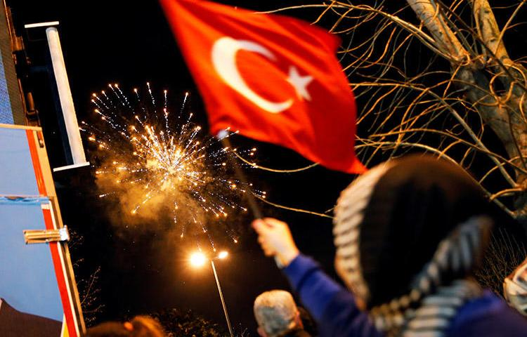 Fireworks are seen in Istanbul on April 1, during elections. A court in the city convicted eight individuals of anti-state charges for their role in a solidarity campaign with the pro-Kurdish newspaper, Özgür Gündem. (Reuters/Kemal Aslan)
