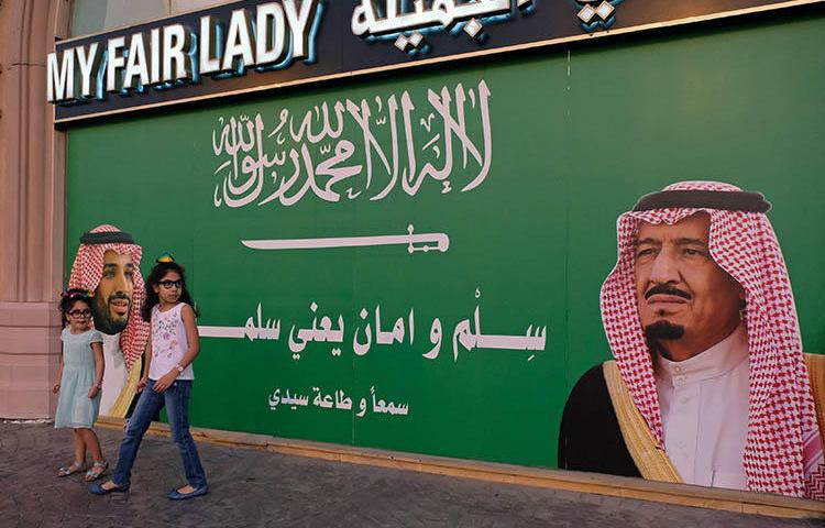 A poster of Saudi Arabia's King and Crown Prince, in Jeddah in November 2017. Medical assessments leaked to The Guardian reveal the abuse of detainees, including at least four journalists, in Saudi prisons. (Reuters/Reem Baeshen)