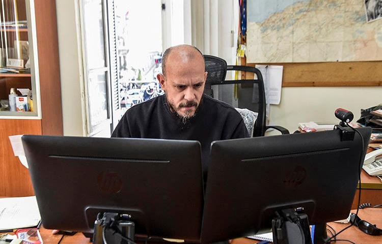Aymeric Vincenot, AFP's Algiers bureau chief, sits at his office on March 1, 2019. Vincenot was recently expelled from Algiers after authorities declined to renew his press permit. (AFP)
