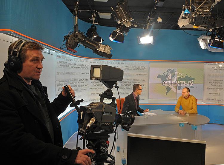 Journalists broadcast from the Belsat TV studio in Warsaw, Poland, on January 31, 2011. The broadcaster's Minsk, Belarus, offices were recently raided by police in a slander case. (AFP/Janek Skarzynski)