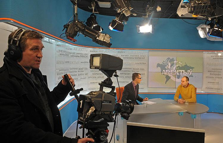 Journalists broadcast from the Belsat TV studio in Warsaw, Poland, on January 31, 2011. The broadcaster's Minsk, Belarus, offices were recently raided by police in a slander case. (AFP/Janek Skarzynski)